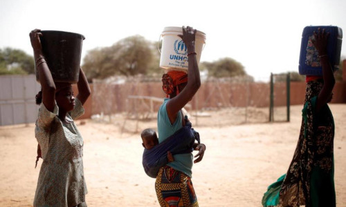Women fetching water during the regional anti-insurgent Operation Barkhane in Tin Hama, Mali